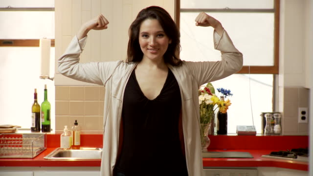 ms zi zo portrait of young woman flexing muscles standing in kitchen, brooklyn, new york city, new york state, usa - flexing muscles stock videos and b-roll footage