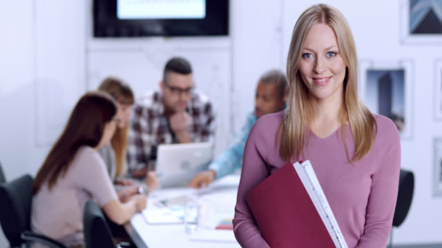 Portrait of young woman in business startup environment