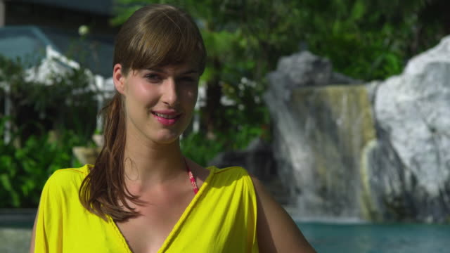 cu portrait of young woman in hotel resort in tropical surroundings, krabi, thailand - see other clips from this shoot 1459 stock videos and b-roll footage
