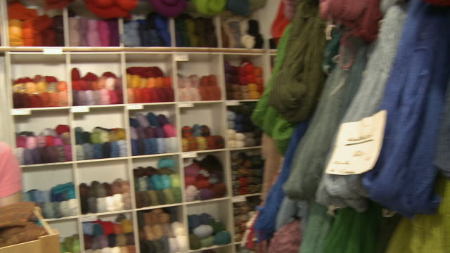 cu, pan, portrait of young woman in knitting store, berlin, germany - ball of wool stock videos & royalty-free footage