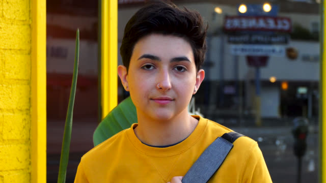 portrait of young woman in yellow sweatshirt - shoulder bag stock videos & royalty-free footage