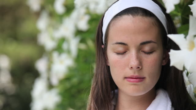 cu pan portrait of young woman next to wall flowers at spa / richmond, virginia, usa - bush stock videos & royalty-free footage