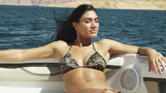 slo mo ms portrait of young woman relaxing on boat on lake powell / utah, usa - lake powell stock videos and b-roll footage