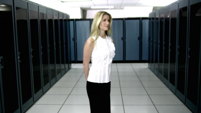ws ds cu portrait of young woman standing in server room - see other clips from this shoot 1480 stock videos and b-roll footage