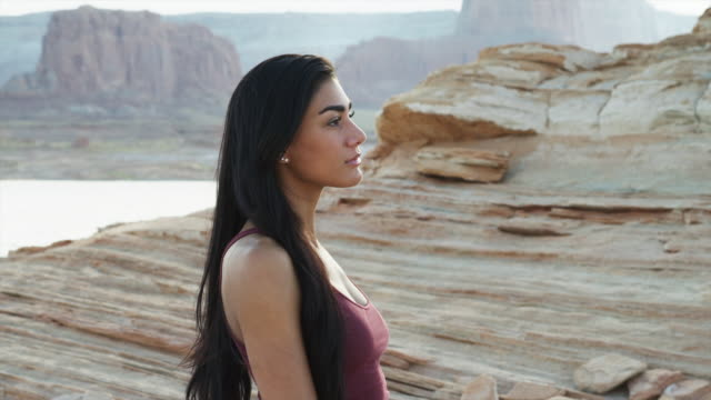 MS ZI CU Portrait of young woman standing near Lake Powell / Utah, USA