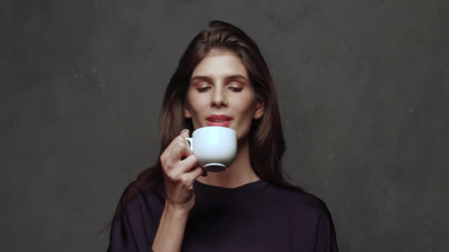 portrait of young woman talking on cell phone - tea cup stock videos & royalty-free footage