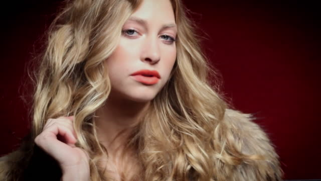 CU SLO MO Portrait of young woman wearing fur coat / New York City, USA