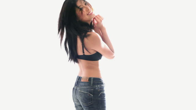a93a961bb MS Portrait of young woman wearing jeans and bra, studio shot - stock video