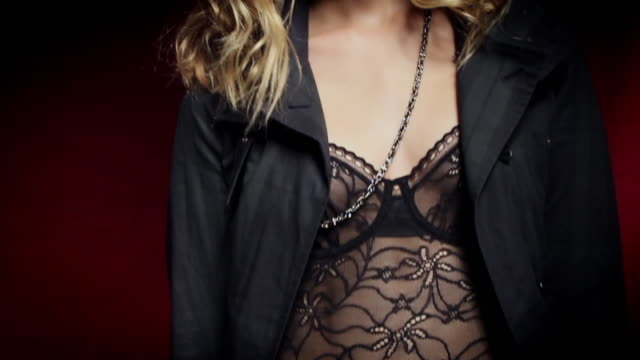 CU SLO MO TU Portrait of young woman wearing lingerie and coat / New York City, USA
