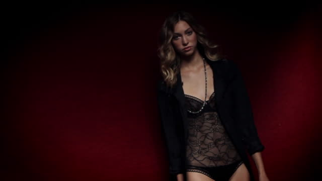 ms slo mo portrait of young woman wearing lingerie / new york city, usa - 2010 video stock e b–roll