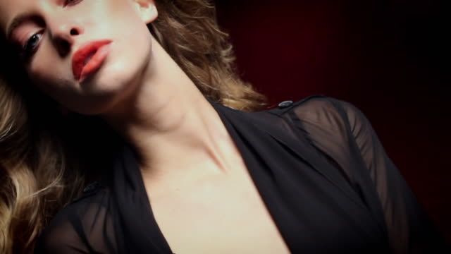 CU SLO MO Portrait of young woman wearing red lipstick / New York City, USA