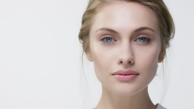 portrait of young woman with beautiful blue eyes - model stock videos & royalty-free footage