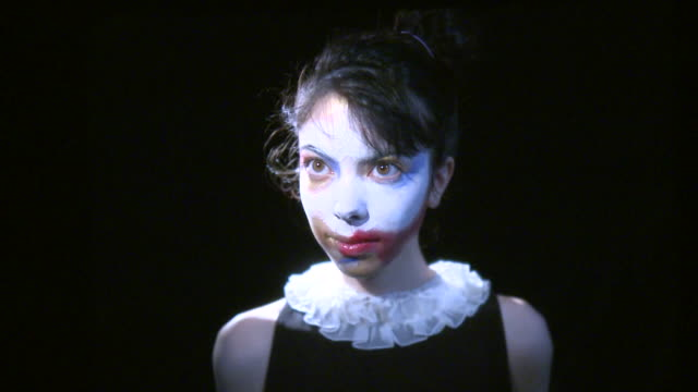 cu portrait of young woman with painted face, new york city, new york, usa - chiaroscuro stock videos and b-roll footage