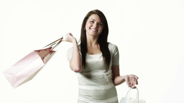 ms tu portrait of young woman with shopping bags against white background / orem, utah, usa - orem utah stock videos & royalty-free footage