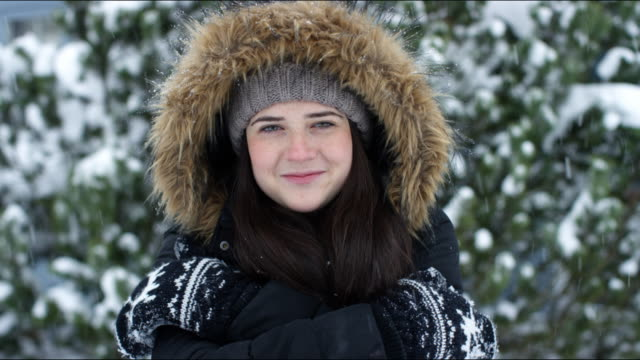 Portrait of young woman with snowball, Winter, Vermont