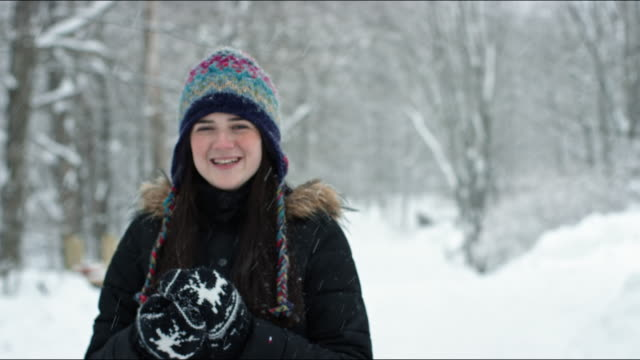 portrait of young woman with snowball, winter, vermont - aufblenden stock-videos und b-roll-filmmaterial