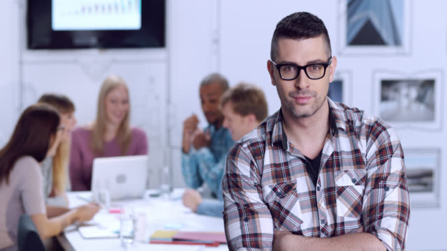 Portrait of younger man in business startup environment