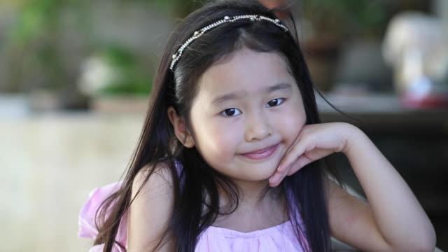 portrait: preschool girl - hair toss stock videos & royalty-free footage