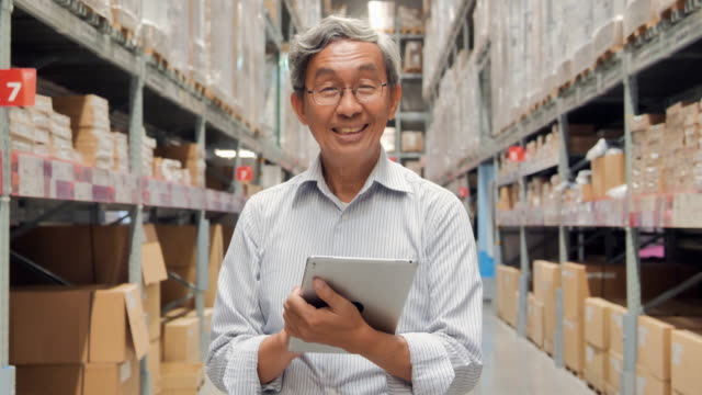 portrait senior men looking at camera and holding a tablet at warehouse.smart warehouse management system.warehouse,technology,people,innovation,leadership,business,finance,success,retirement,transportation,online shopping.video: diverse portraits - ordering stock videos & royalty-free footage