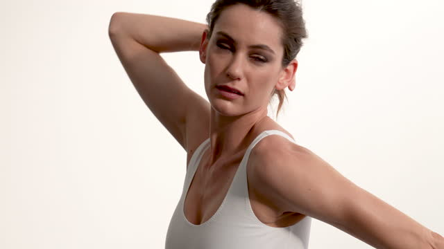 portrait shot of a classical ballet dancer dancing against a white backdrop - leotard stock videos & royalty-free footage