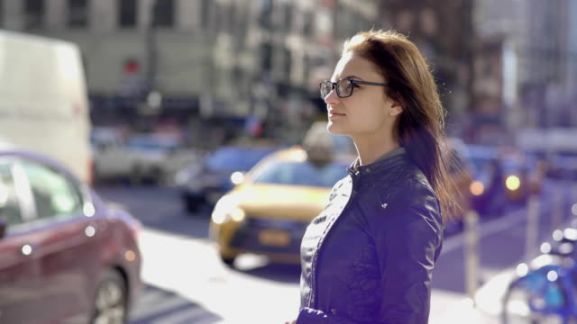portrait shot of young attractive women standing on street in the city. urban people lifestyle background