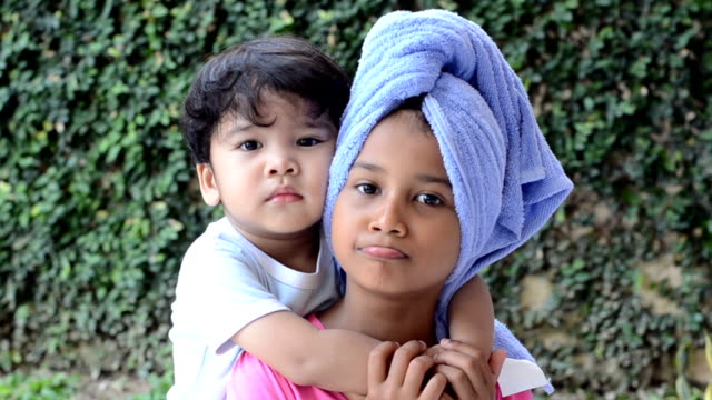 portrait siblings - wrapped in a towel stock videos and b-roll footage