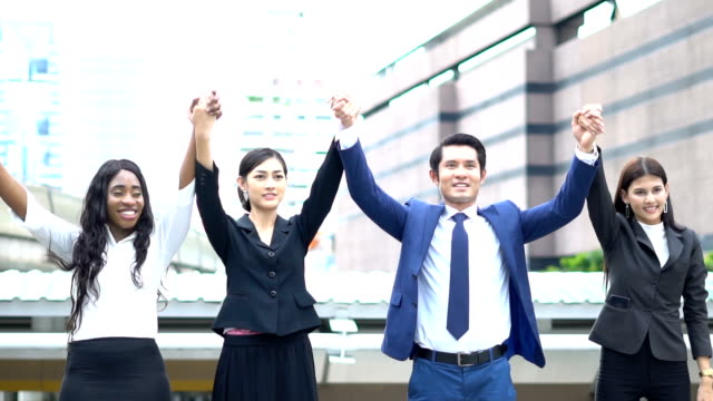 Portrait smiling businesswoman and man  in the big capital city while they are acting success