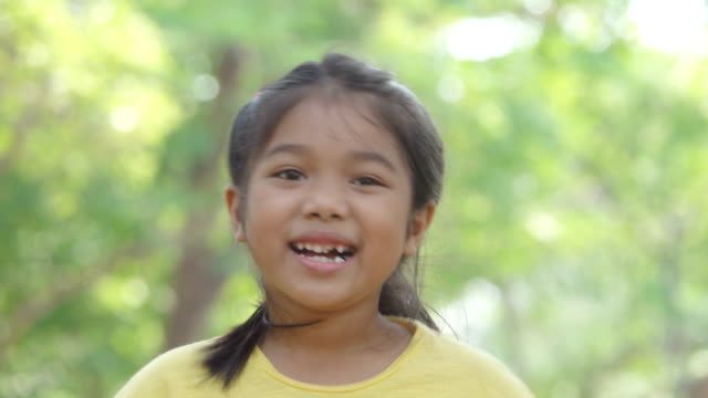 portrait smiling girl in park - cambodia stock videos and b-roll footage