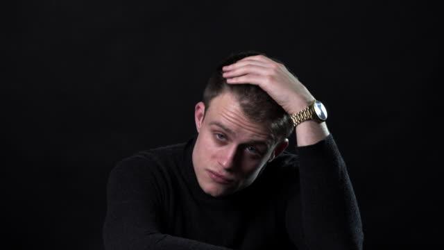 vídeos y material grabado en eventos de stock de a portrait style film of a man with a watch on a black background - fondo negro