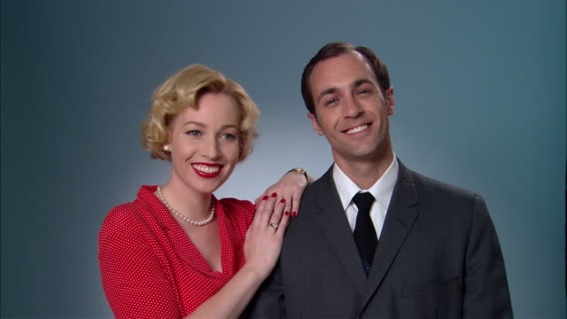 ms portrait woman in red polka dot dress and man in suit/ woman leaning on man's shoulder and smiling/ new york city - polka dot stock videos and b-roll footage