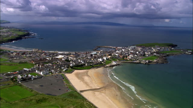 portrush  - aerial view - northern ireland, coleraine, united kingdom - ulster county stock videos & royalty-free footage