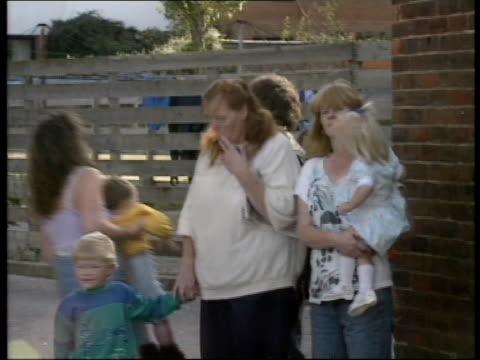 Asbestos contamination ITN ENGLAND Hants Portsmouth Lumsden Road Estate LMS Houses TILT DOWN children playing on asbestoscontaminated grass CMS...