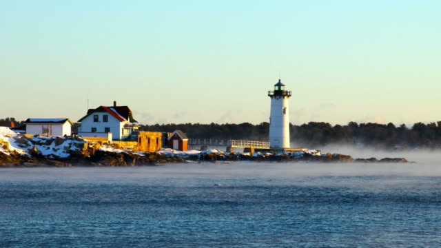 portsmouth harbor lighthouse in arctic sea smoke - new hampshire stock videos & royalty-free footage