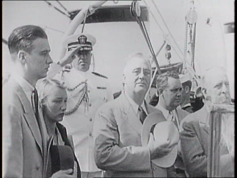stockvideo's en b-roll-footage met portsmouth naval yard / naval officers standing at attention on shipyard dock / onboard the presidential yaht ss potomac, fdr, his son john roosevelt... - 1940