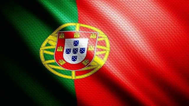 vídeos de stock, filmes e b-roll de bandeira de portugal 4k - bandeira