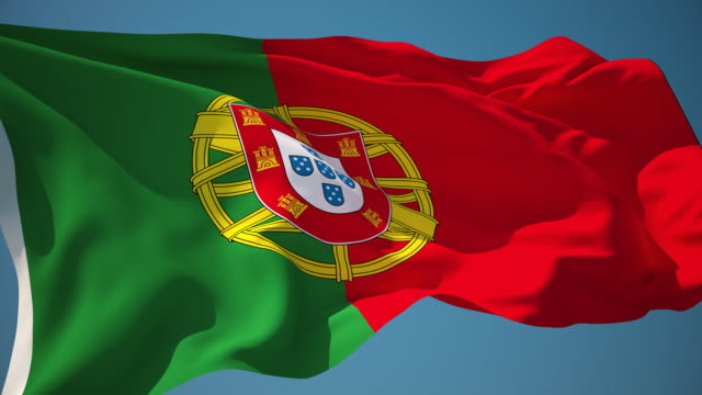 4k portugal flag - loopable - portugal stock videos & royalty-free footage