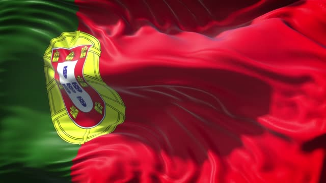 portuguese flag is waving slowly in full screen 4k resolution - national flag stock videos & royalty-free footage