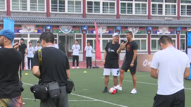 portuguese footballer cristiano ronaldo visits beijing haidian minzu primary school and plays football with students on july 19 2018 in beijing china - education building stock videos & royalty-free footage