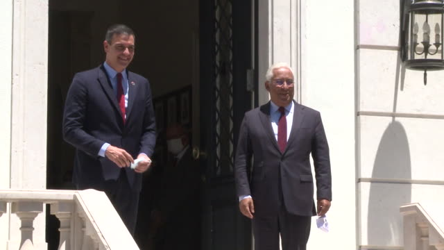 portuguese prime minister antonio costa greets his spanish counterpart pedro sanchez upon his arrival for a meeting at the sao bento palace. - prime minister bildbanksvideor och videomaterial från bakom kulisserna