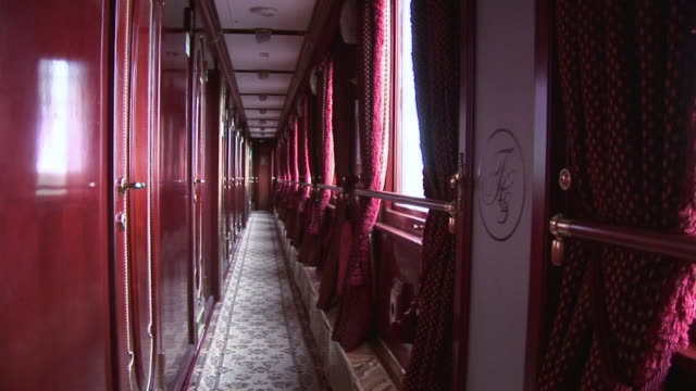ws posh interior of train hallway in berth area / russia - letterbox format stock videos & royalty-free footage