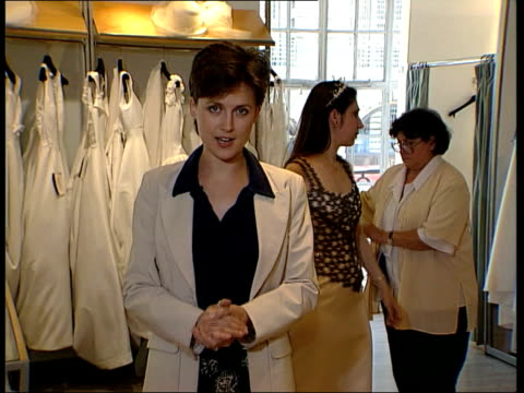stockvideo's en b-roll-footage met posh spice and david beckham wedding lib ext victoria adams and david beckham posing for photocall following the announcement of their engagement cs... - 1999