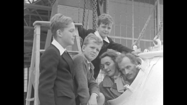 stockvideo's en b-roll-footage met posing for photo opportunity engineer/balloonist jean piccard and his wife jeannette lean out of open hatch of gondola their three sons standing next... - hatch
