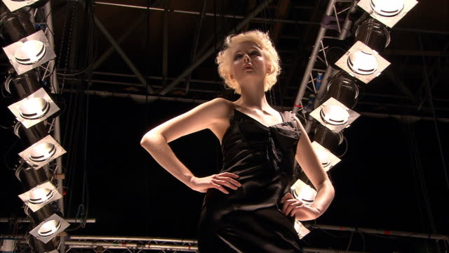 la ws posing on catwalk as photos are taken of her/ london, england - fashion show点の映像素材/bロール