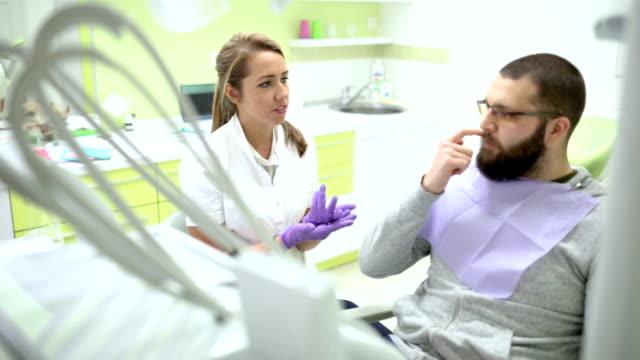 positive atmosphere at dentist's - igiene dentale video stock e b–roll