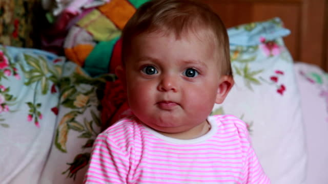 positive baby looking at camera - part of a series stock videos & royalty-free footage