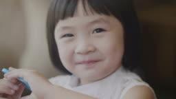 Positive Emotion Portrait of Asian Little Girl