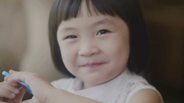 positive emotion portrait of asian little girl - baby girls stock videos & royalty-free footage