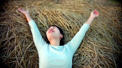 positive emotion : women arms outstretched on straw - obscured face stock videos & royalty-free footage