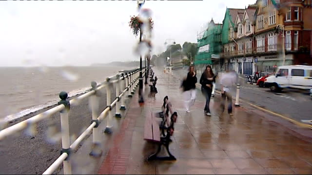 positive weather solutions predict a barbecue august 2009 various of people on rainy seafront ends - august stock videos & royalty-free footage