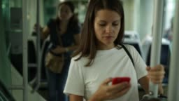 positive woman using mobile phone while traveling